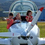children in a plane on bovec airfield; photo by: www.janezlet.si