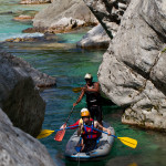 family canoeing in triglav national park