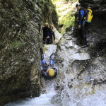 sliding down a small waterfall in sušec canyon