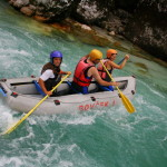 canoeing on the soča river with a guide in the boat