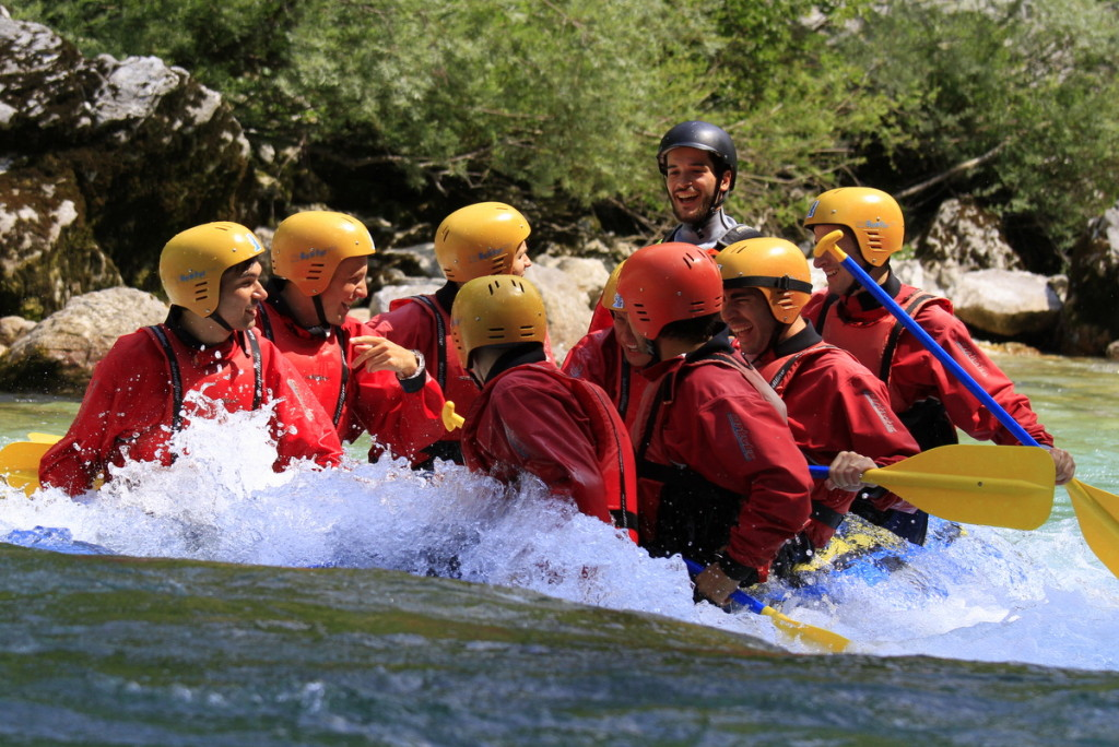 guide doing a submarine on soča rafting