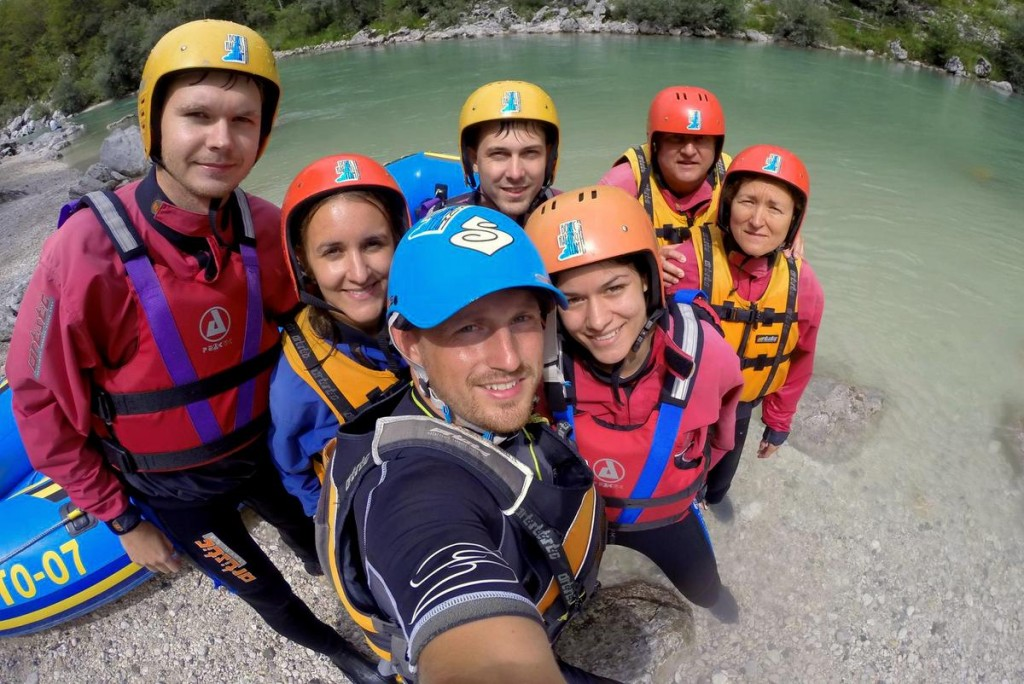 guide taking selfie with guests after rafting on soča