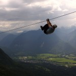 zip line in soča valley with bovec at the back; photo by: www.ziplineslovenia.si