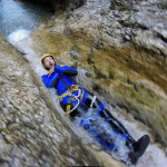 sliding down the waterfall in sušec canyon slovenia
