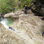 waterfall sliding in sušec canyon in slovenia