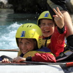 family rafting with two girls on board
