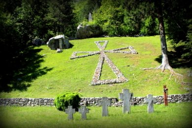 cross on the hill of first world war military cemetery in soča village slovenia