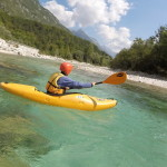 practicing new paddling skills on kayak course in slovenia