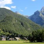 paragliding in slovenia with log pod mangartom village at the back; photo by: Tatjana Wojčicki