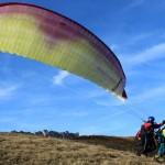 tandem paragliders taking off the mount mangart soča valley; photo by: Tatjana Wojčicki