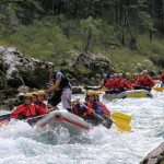 three rafting on the rapids section of the soča river