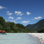 rafting on the soča river with mountain views