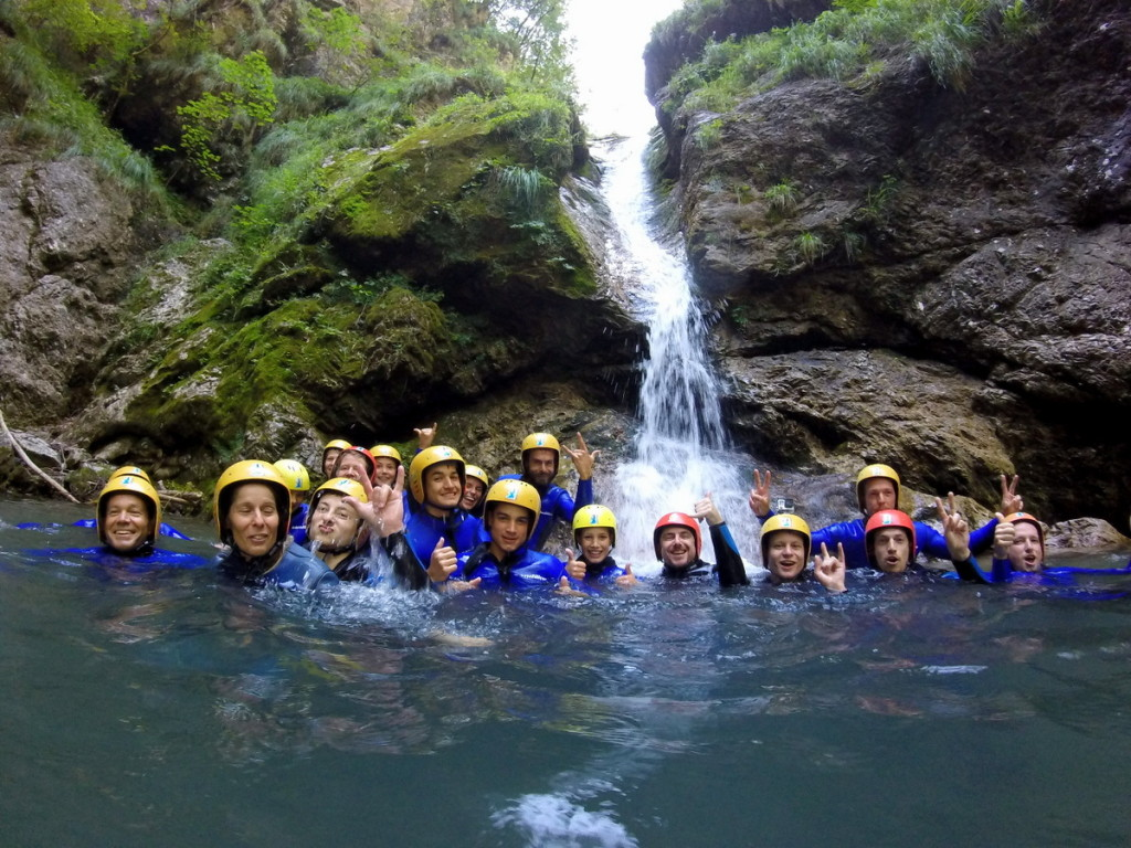 Group Of Friends Under The Waterfall In Susec Canyon