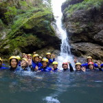 group of friends under the waterfall in sušec canyon