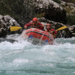 canoeing on wild rapids of soča river in bovec