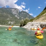friends on kayak course on the soča river