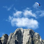 paragliders and mountain peaks of triglav national park slovenia; photo by: Tatjana Wojčicki