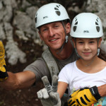 guide with a child on family zip line in bovec; photo by: www.ziplineslovenia.si