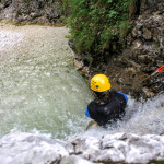 sliding down a waterfall in fratarca canyon soča valley