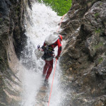 repelling the waterfall in fratarca canyon slovenia