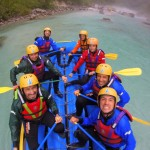 friends rafting in rain on the soča river
