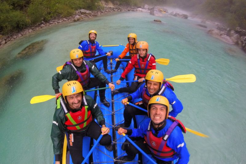 friends rafting in rain on the soča river
