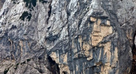 shape of a girl face on the slope of mt prisank on vršič pass in slovenia