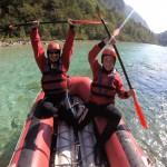 father and son on canoe trip on soča river
