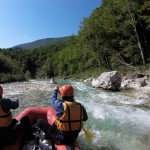 canoeing on the rapids of soča river