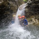firends showering under the waterfall in sušec canyon