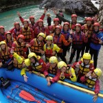 happy guests after rafting on the soča river