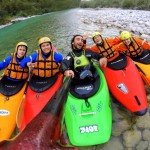 guests having fun on kayak course on soča river