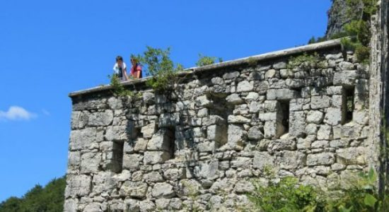 boys at predel fortress in slovenia on a summer day