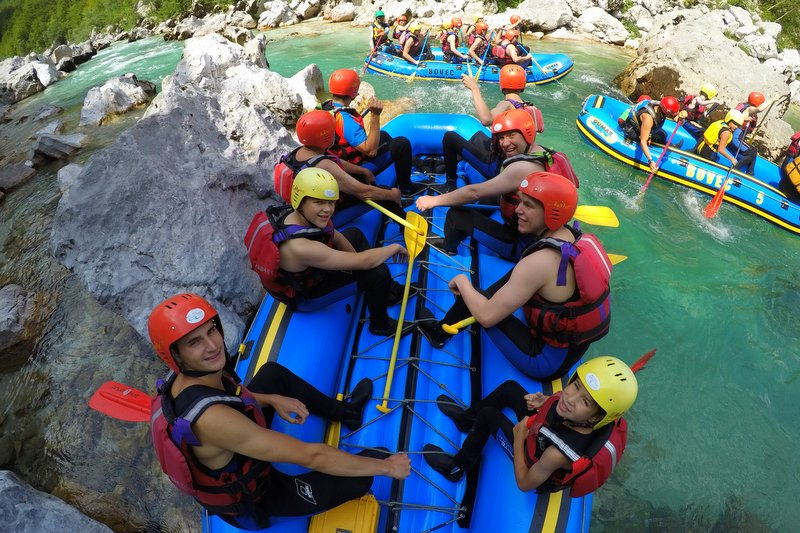 group of friends having fun on rafting tour